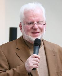 Dieter Krowatscheck hält einen Vortrag auf dem Kinderkongress 2009